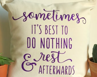 A 'Sometimes it's best to do nothing & rest afterwards' cushion cover in natural or white.
