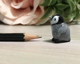 Baby penguin figurine.