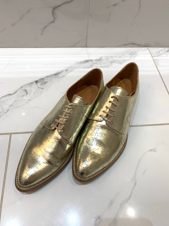 Leather gold shoes