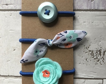 Trio of elastic with button, loop and Mint felt flower.