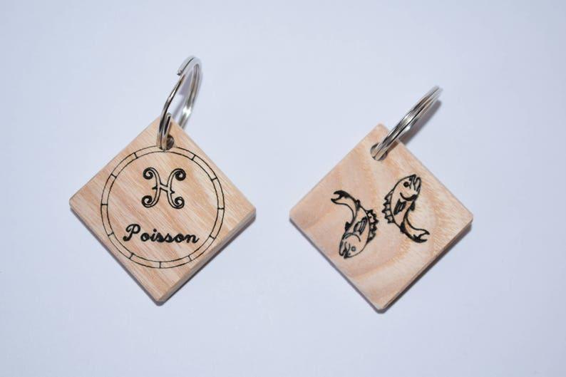 Zodiac sign fish wooden keychain.