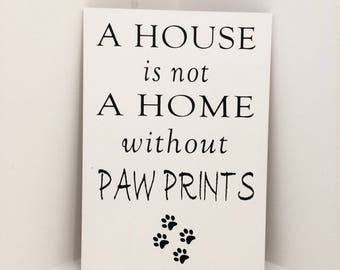 A house is not a home without pawprints, wooden sign