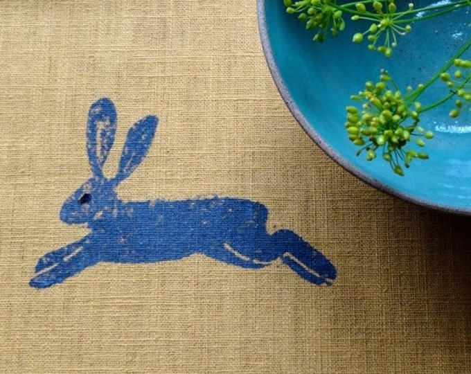 table runner hares on mustard linen