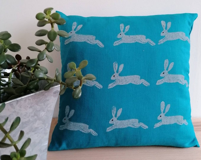 leaping hare cushion blue