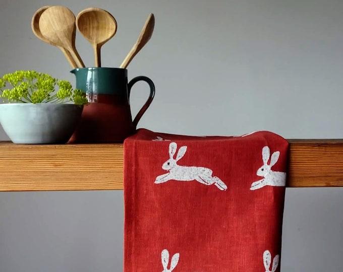 hares rust linen tea towel