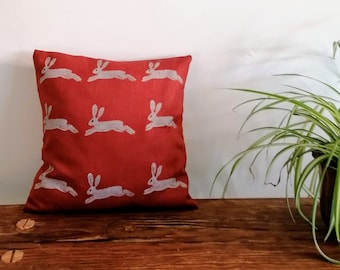 leaping hare cushion rust