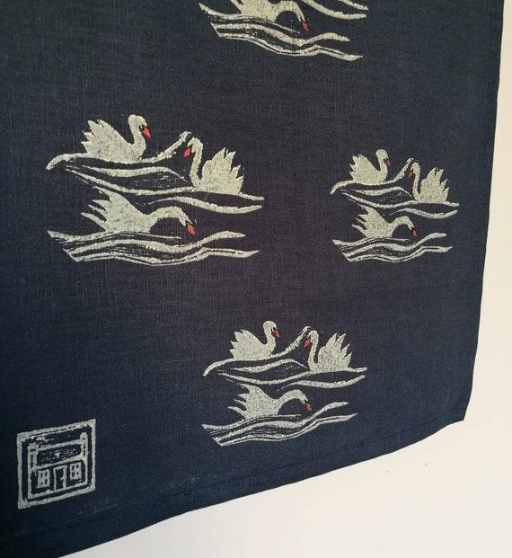 swimming swans teatowel
