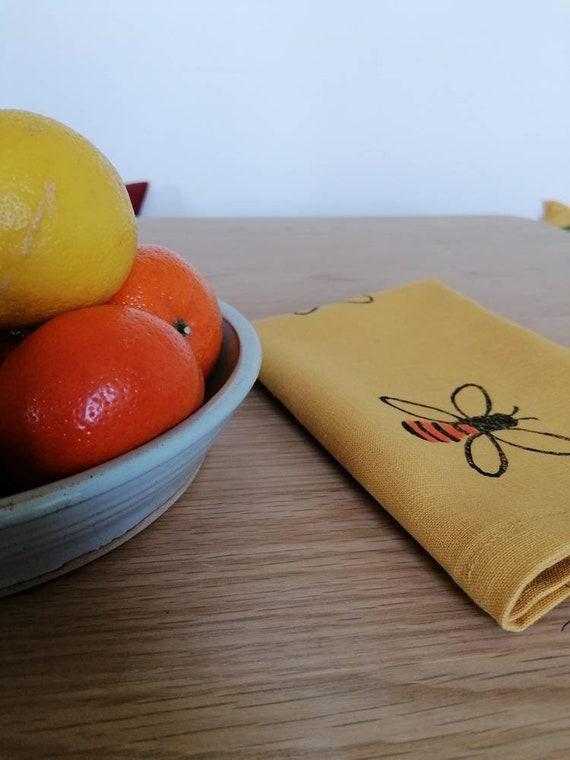 bee teatowel mustard