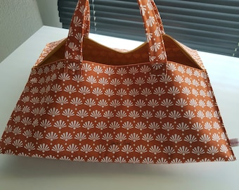 Bag has cake pie inside fabric coated
