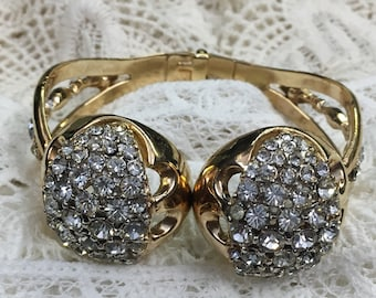 Gold tone and crystal hinged cuff bracelet