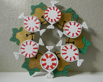 Christmas wreath with candy and jingle bells.