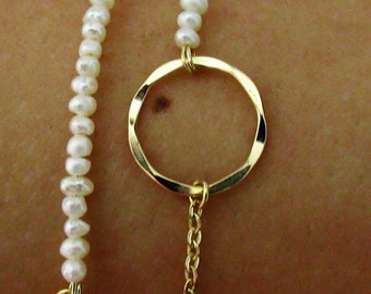 A goldfilled bracelet with a hammered loop and Fresh water pearls