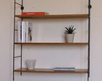 Scandinavian hanging shelf made of metal and wood from the 60s