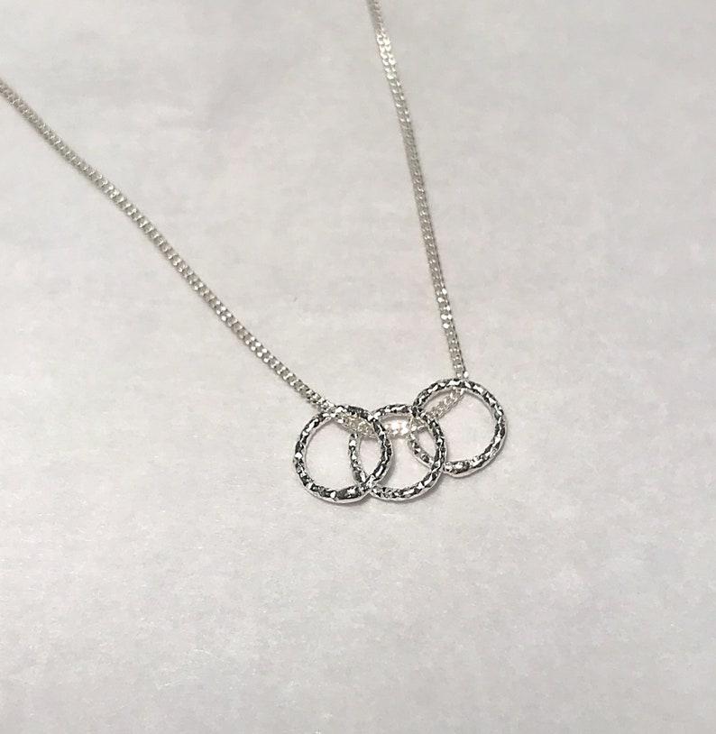 Small circle silver pendant image 0