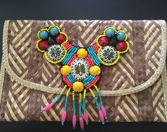 Straw clutch with ethnic beading.