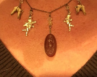 Antiques and teeth necklace