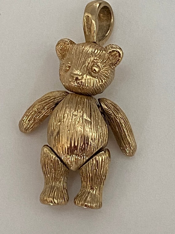 Moveable gold teddy pendant