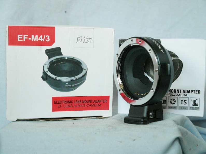 Inst New-Unused- Electronic Adaptor For Canon EF EF-S EOS Lens to Micro 43 M43 Mft Panasonic Camera Boxed