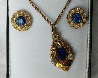 Blue and white rhinestone pendant and screwback earrings