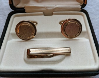 Gold-tone cuff links and tie bar