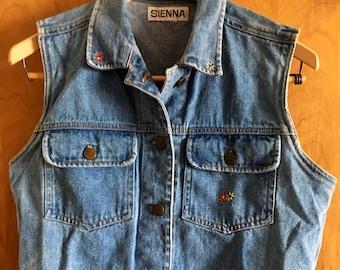Vintage clothing denim vest with flower details