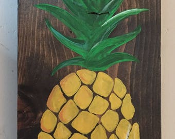 Pineapple painting on wood surface