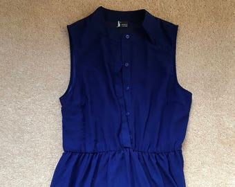 Dark blue buttoned sleeveless no collar dress