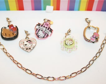 Hello Kitty Bracelet and 5 Charms Mirror, Pirate, Shield, Flower & Hello Kitty Icon - Charm It