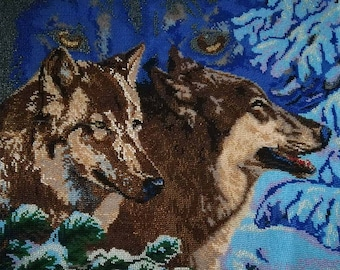 Wolves in the winter forest - a picture embroidered with beads