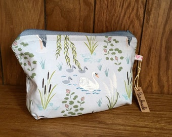 Swans make up bag