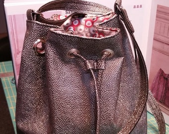 Brown faux leather purse bag, lined with shoulder strap