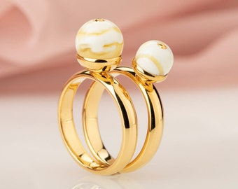 24k gold stacking rings set with white Baltic amber