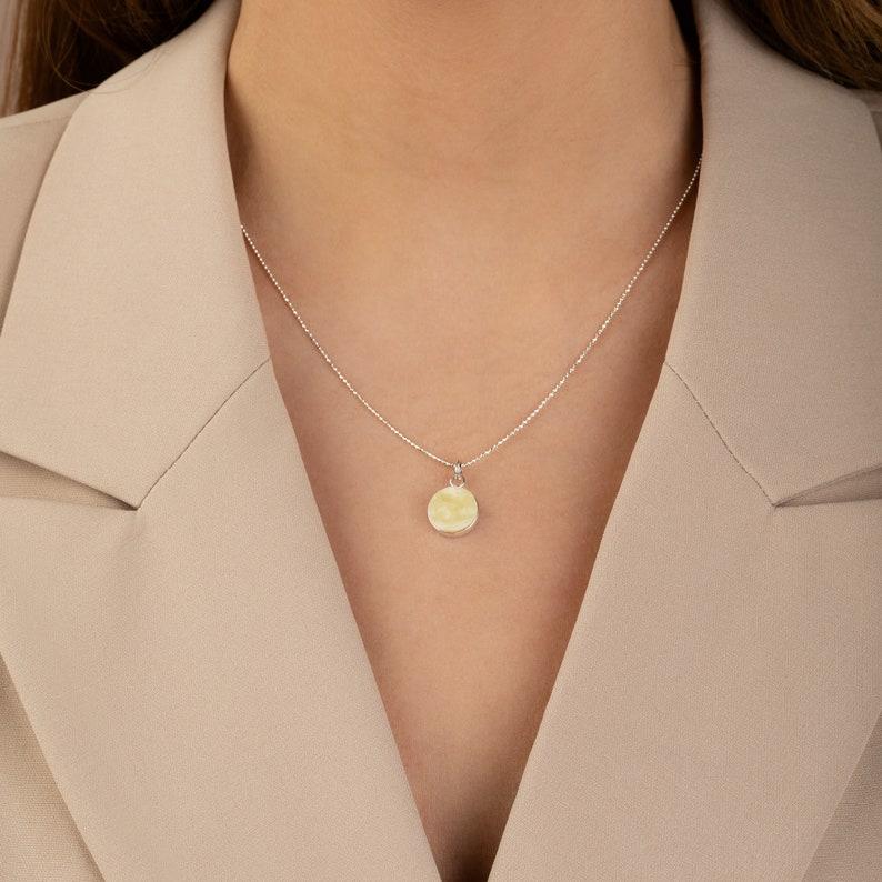 Round amber pendant Modern amber jewelry Geometric pendant image 0