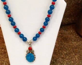 16mm blue apatite and coral beads with matching stunning druzy pendant