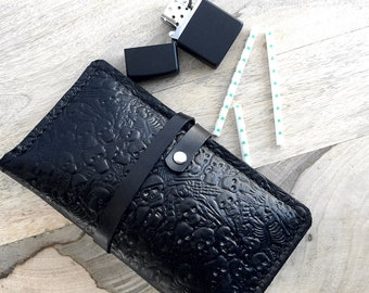 Black leather tobacco pouch with a skull print and inner pockets