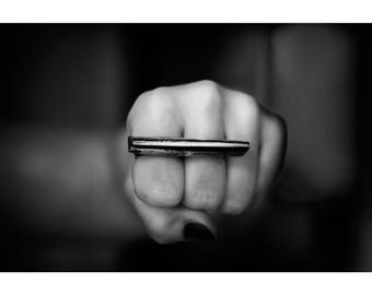 Severity. Raw silver knuckleduster ring. Big, minimalistic, heavy, contemporary, modern. Sterling silver. Double ring. Fight. Triangle.