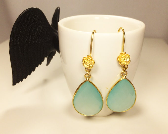 Elegant earrings with an aqua Chalcedony drop and a gold rose detail.