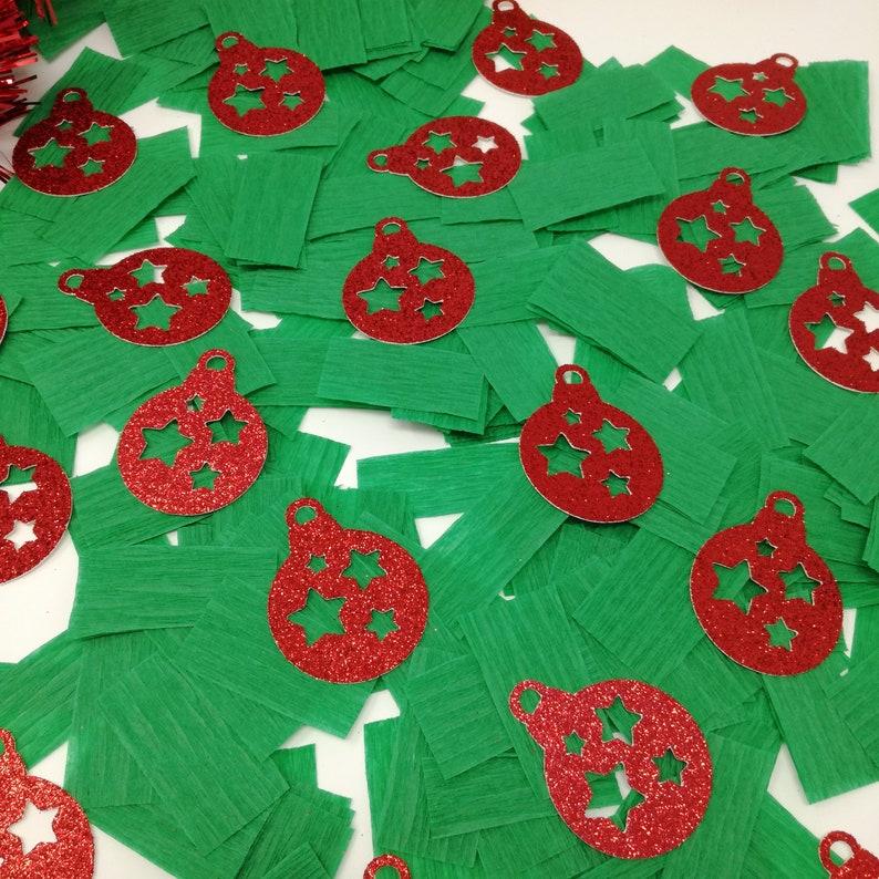 Christmas ornament confetti with green crepe paper. Christmas decoration.  Christmas table decorations. Holiday Season Confetti