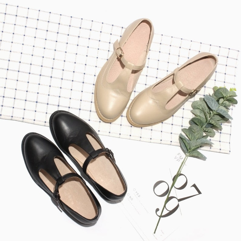 1920s Fashion & Clothing | Roaring 20s Attire Customizable Genuine Leather Retro Mary Janes Flat ShoesWomens T Straps Flat ShoesComfortable Black Girls Mary Janes $89.00 AT vintagedancer.com