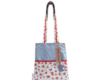 Handmade child's handbag with double pocket and heart detail.