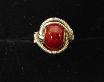 Wire wrapped red glass bead ring