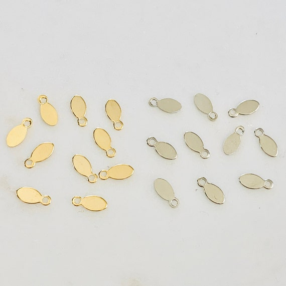 10 Pieces Tiny Base Metal Beaver Tag Stamping Pointed Oval Tag Charm 9mm x 4mm Shiny Gold, Nickel Silver Jewelry Supply