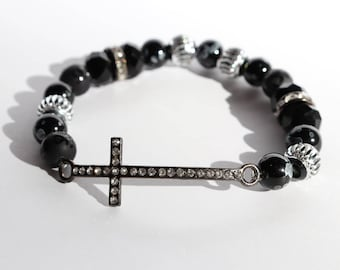 Black and silver beaded bracelet with cross charm