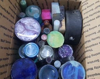 Medium flat rate box packed full of over fill cups and resin castings.