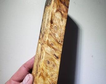 Stabilized buckeye burl handle block. Knife scales