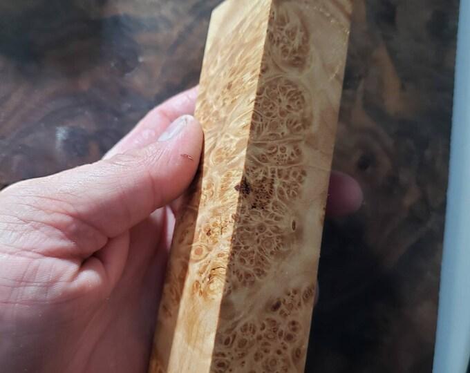 Stabilized maple burl knife block.