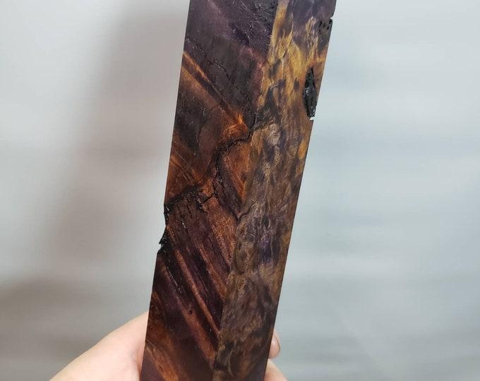 Dye stabilized maple burl block