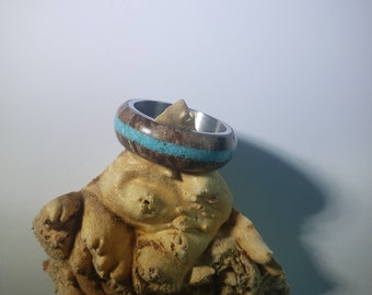 Stabilized maple burl ring with turquoise inlay and steel core.