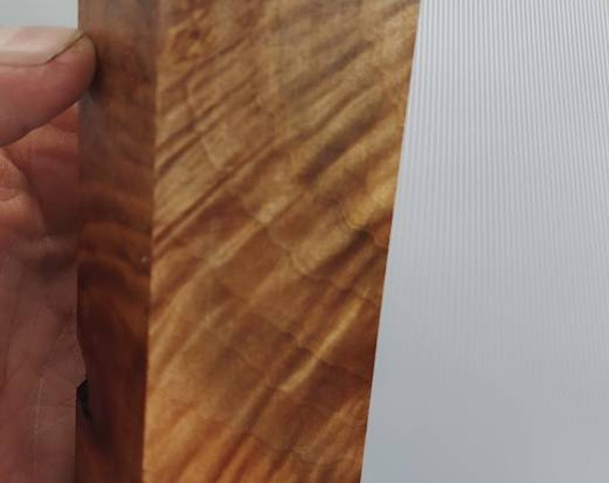 Stabilized madrone burl knife block.