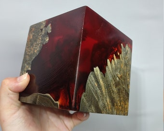 Beautiful dye stabilized black maple burl and red alumilite cube.